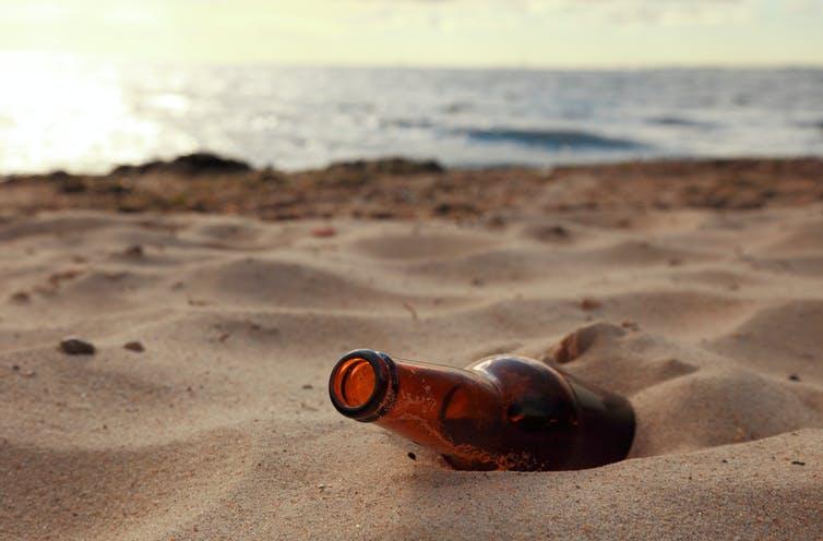 empty beer bottle on beach