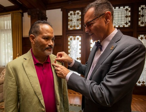 Representative Garnet Coleman visits campus and receives UST pin from UST President Richard Ludwick