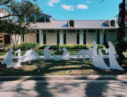Wooden Cutouts Nativity Scene in front of Keon House on campus