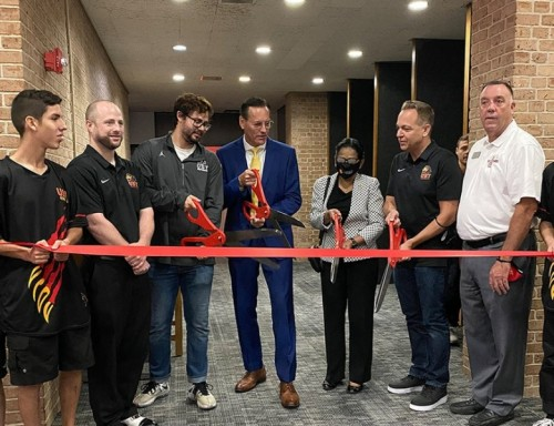 (L to R) Esports team player Anthony Dominguez; VP of Finance Spencer Conroy; Assistant Director and Coach for Esports Justin Pelt; UST President Richard Ludwick; Chief Innovation Officer Beena George; VP of Marketing Jeff Olsen and Director of Development Jeff Doherty help cut the ribbon to the new esports facility at UST/photo credit Brittany Wright, UST