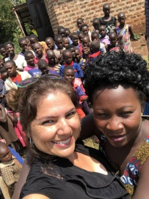 Maria Moreno with the principal of the school at the Kitoonya Orphanage School in Hoima.