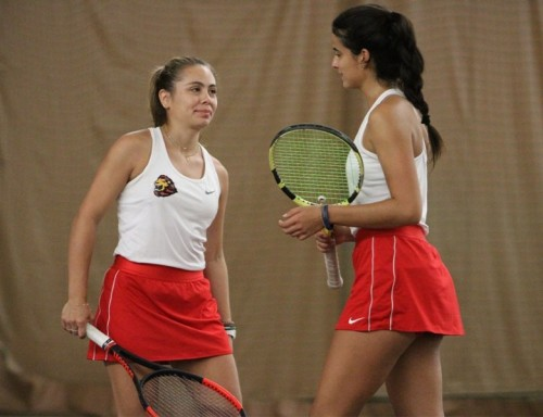 Anamaria Gonzalez (left) and Alejandra Lopez (right) compete in the Doubles at the ITA Regional Championship.