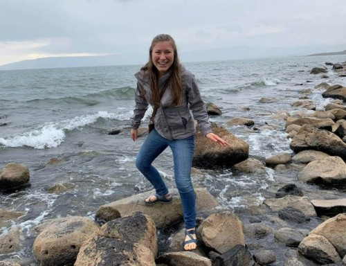 Audrey Novak balances on rocks at the Sea of Galilee