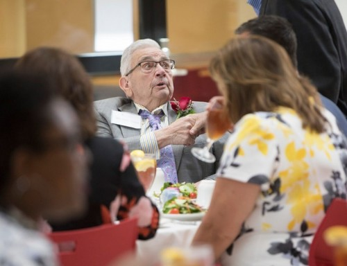 Odis Peavy sharing lunch with nursing students on campus