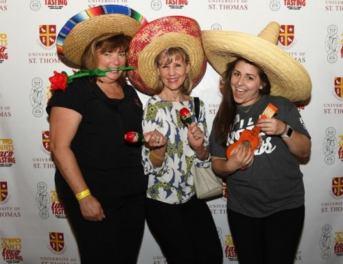 First Lady Melynda Ludwick, Cindy Viaud from the Office of the President and Leslie Meigs pose with sombreros.