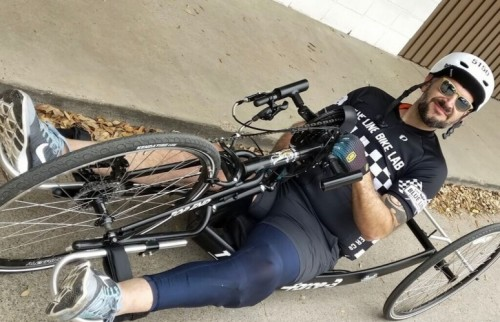 Dean Chagaris poses for a photo in his handcycle.
