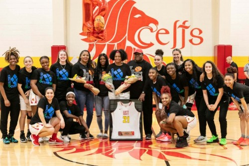 The women's basketball team poses for a photo while wearing the Celts to Cure shirts.