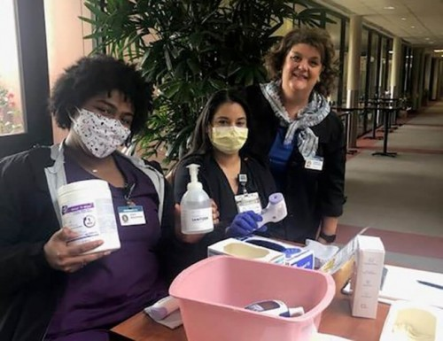 Toni Cotton (far right)  visiting with front line nurses screening patients for COVID
