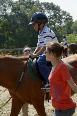 HSS Adaptive Sports Academy at Endeavor Therapeutic Horsemanship in Mount Kisco - Close up of Edwin riding Koko