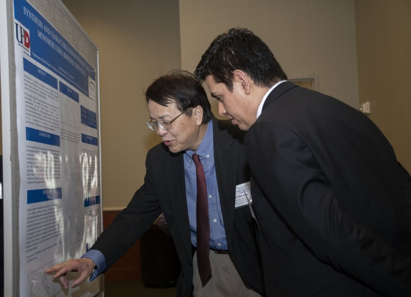 students presenting a research poster